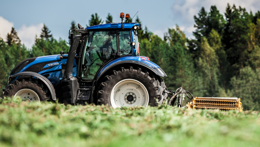 valtra tractor and twintrac on field
